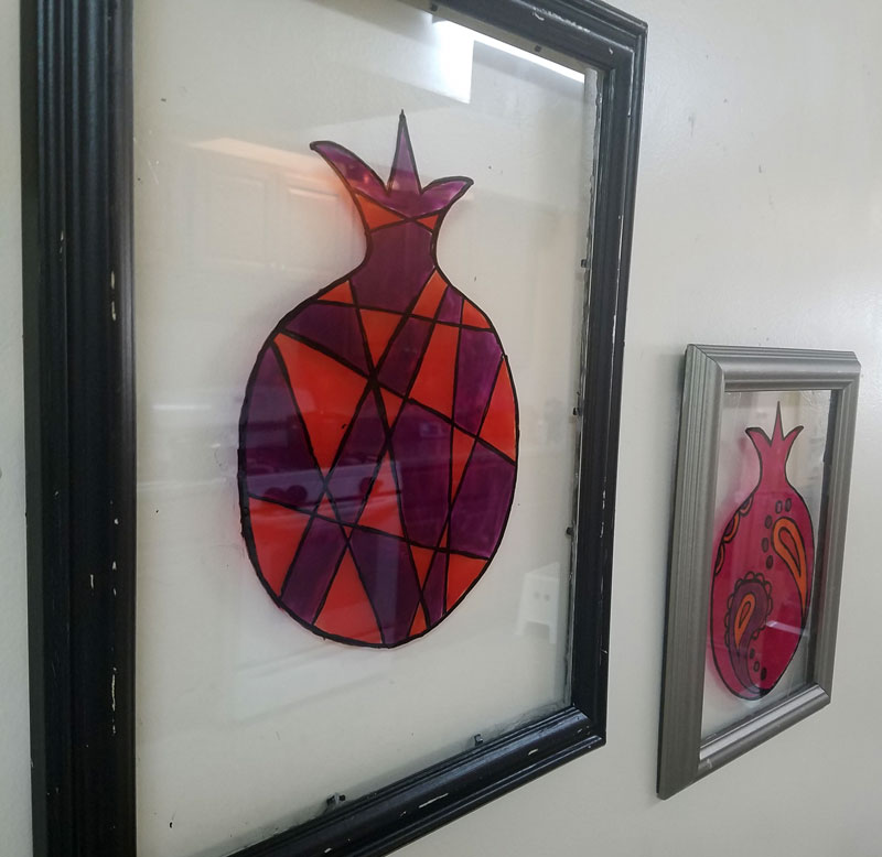 Make stained glass pomegranate wall art as a cool DIY sukkah decoration idea for teens or adults - this beautiful Judaica wall art idea is water resistant making it perfect for outdoors! You can use it for Sukkot or Sukkos, and then bring it indoors and hang it in your home year-round.