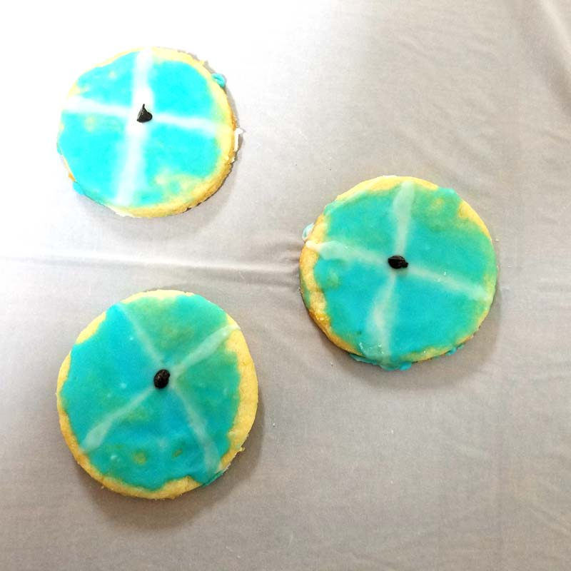 These kippah cookies and tzitzis juice box upsherin treats are so cute! They are adorable for a Jewish third birthday party for boys!