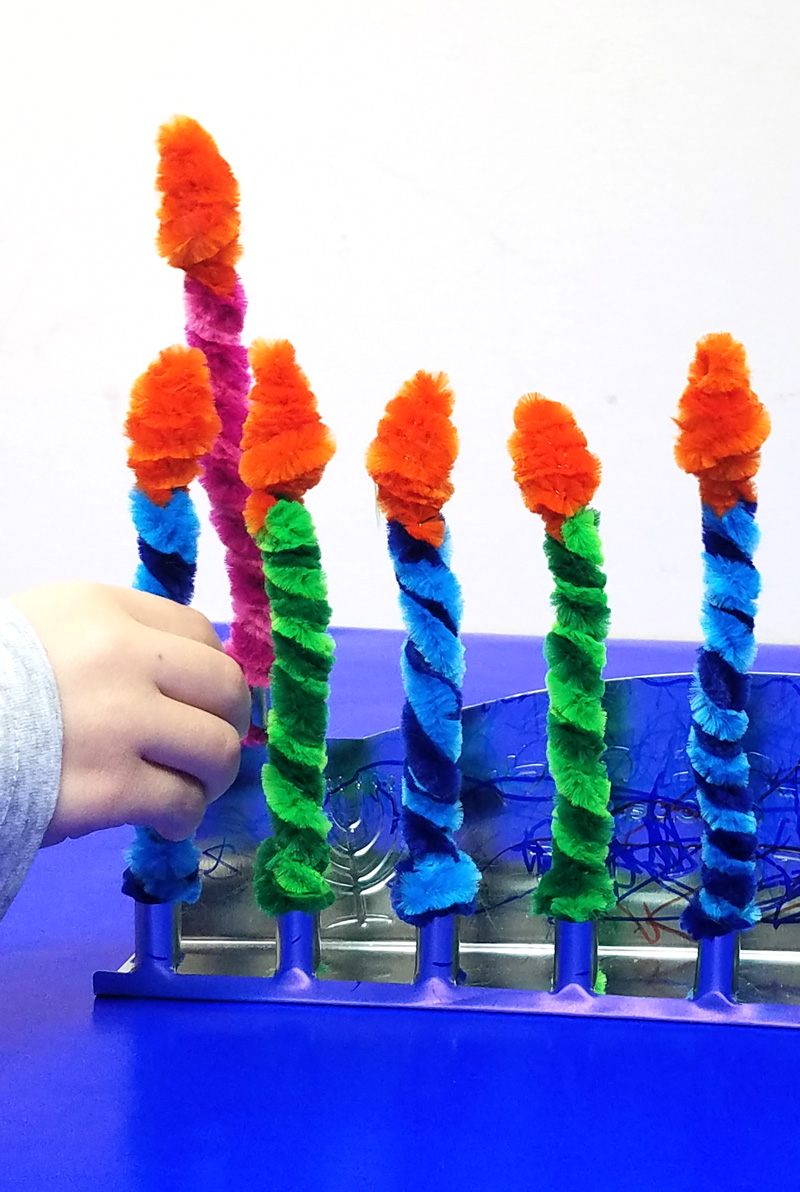 Make these Chanukah candles for kids to keep them safe when lighting the menorah! This fun Hanukkah Craft is a great way to involve your preschooler or toddler with the holiday. #Hanukkah #chanukah