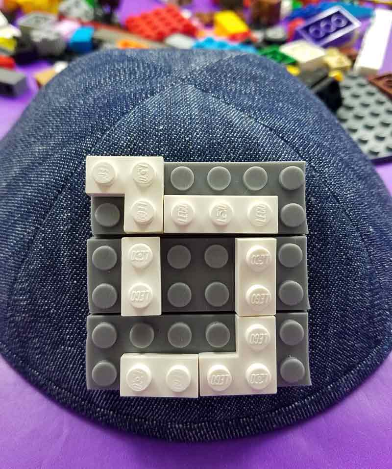 This adorable LEGO Kippah is so easy to DIY and a fun yarmulke craft! It's a cool idea for an Upsherin or 3rd birthday party for Jewish boys and a great Judaica gift idea for kids. #judaica #kippah #beyondthebalagan