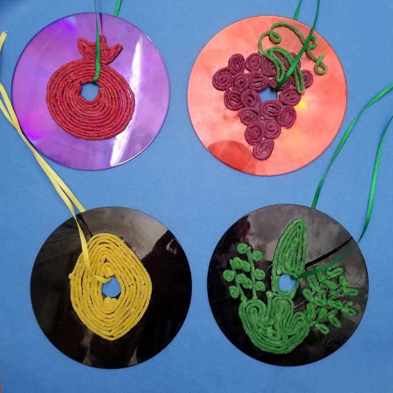 Sukkah deocrations from old CDs with children